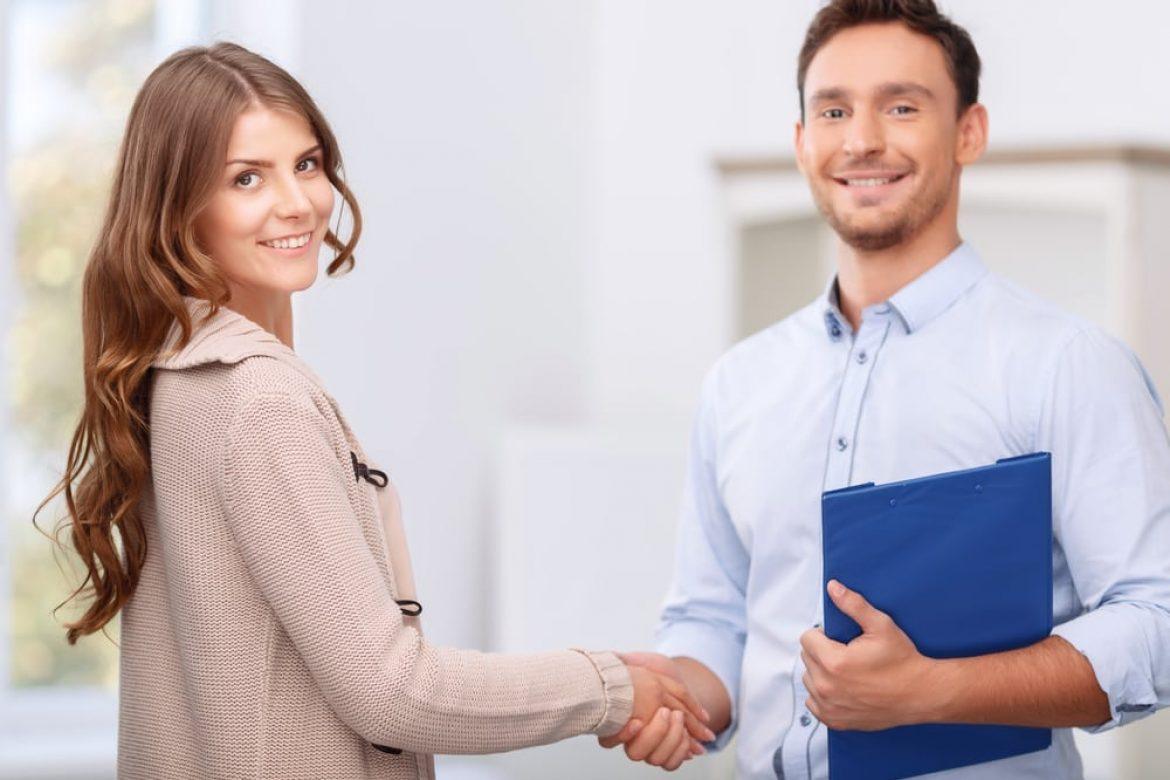 realtor shaking hands with client